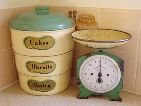 vintage green scale and stacking tins 26 Modern Kitchen Decor Ideas in Vintage Style