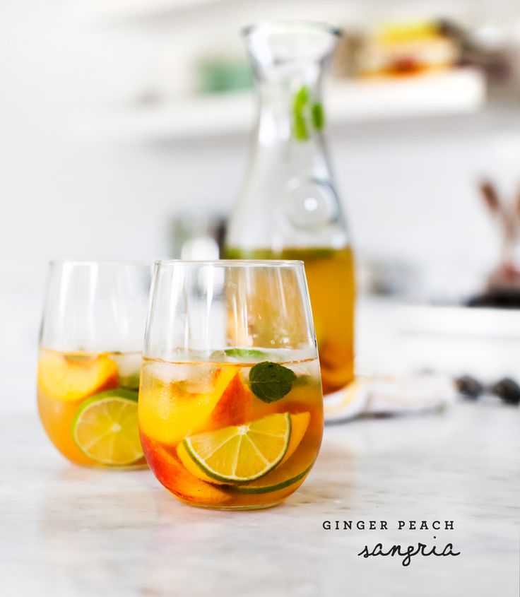 Ginger Peach Sangria | This is sweet, but not too sweet, and packed full of fruit and herbs. @loveandlemons