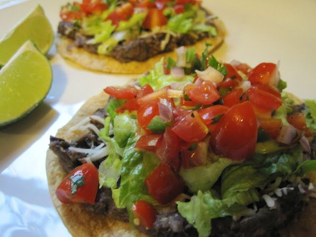 This recipe allows for two Black Bean Tostadas per serving.  Each serving is around 300 calories, 4 grams of fat, and 10 grams of protein according to the My Fitness Pal app.  Ole!