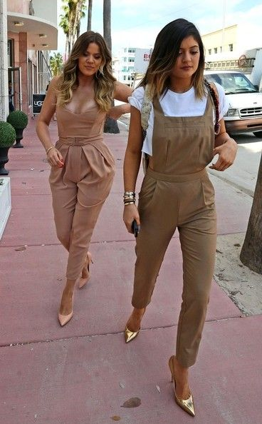 Kylie Jenner glammed up her casual outfit with a pair of gold pointy pumps. ----------------------------------------------------Kylie Jenner kept it youthful yet chic in tan ASOS  overalls while shopping in Miami