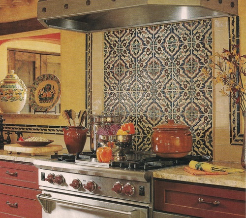 Gorgeous hand-painted tiles are a sure-fire way to add color and style to your worldly look. Such special tile can be expensive, but using it in small doses, add big style without breaking the bank. The red cabinets, yellow walls and well-styled cookery make this kitchen look like it resides in some fabulous little town in the Spanish countryside.