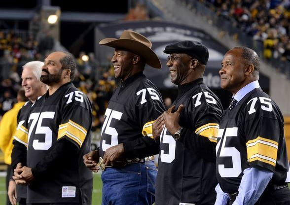 Former Steelers (from left) Andrew Russell, Franco Harris, Mel Blount, John Stallworth and Lynn Swann don Joe Greene jerseys as they celebrate their former teammate as his number was retired Sunday night.