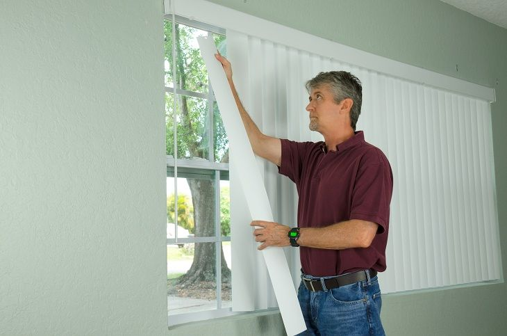 Installing window blinds in a house