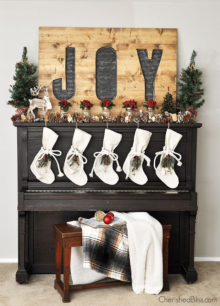 Welcome in Christmas with this beautiful Rustic Woodland Christmas Mantel and DIY Drop Cloth Stockings Tutorial