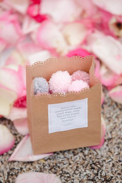"""Pom Pom Confetti: cute idea. The label says, """"When the newlyweds walk your way, toss the pom poms and shout hooray!"""""""