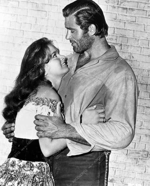A scruffy Clint Walker with unknown actress.