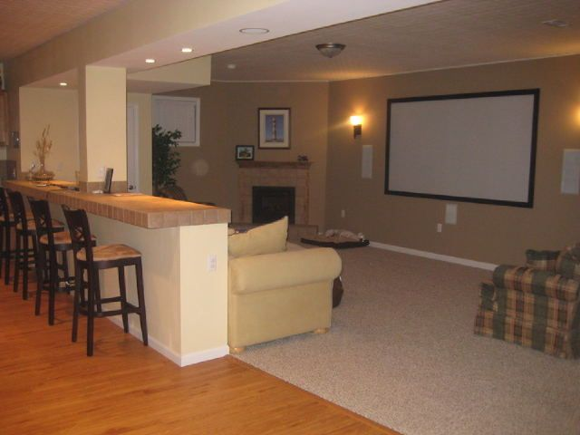 Love all these ideas for the basement.  Not the colors, but the idea of the bar/table behind the couch