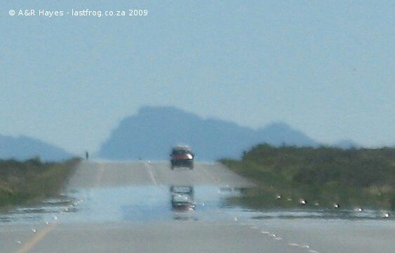 The heat haze shimmers on the road ahead.  N1 outside Beaufort West