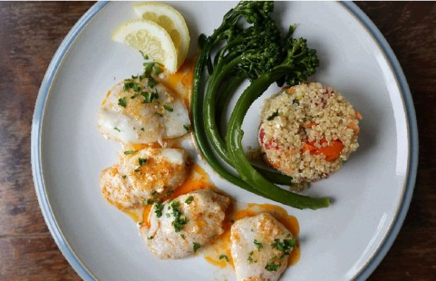 Succulent halibut cheeks roasted with lemon, butter and garlic. Top with a sprinkle of parsley, and serve.