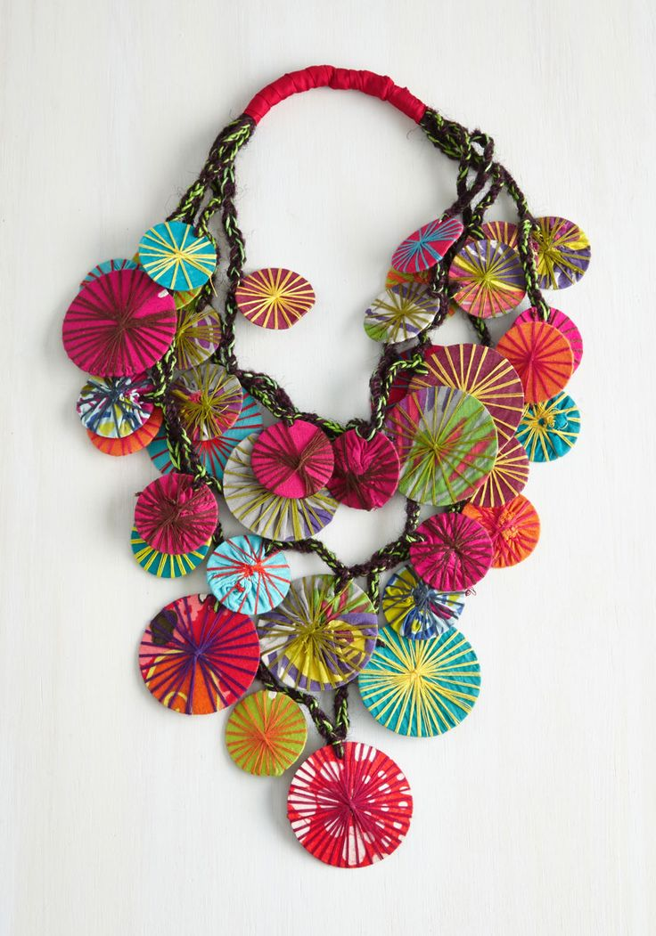 A kiss may be grand, but it can't compare to this exquisite statement necklace. Crafted by Karma Living with a multitude of fabrics and colorful string, this piece will bring out the artistic, indie spirit in every item paired with it. No two necklaces are exactly alike, meaning your special accessory is as unique as you are! Wear it to brighten your casual days, or be daring with a printed V-neck dress. After all, who needs diamonds when there are so many colors to wear?