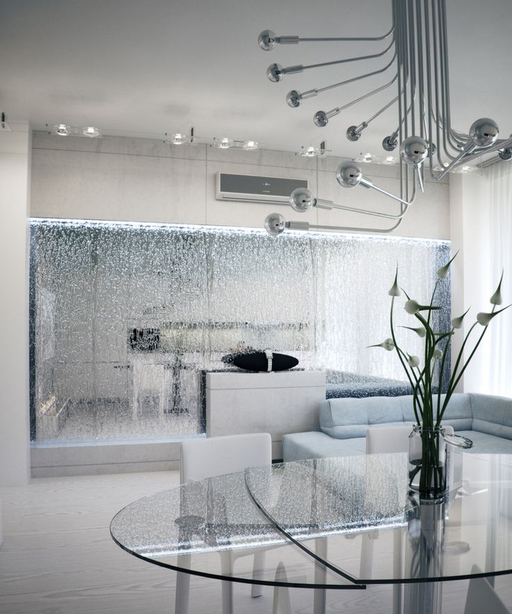 This #silver and #futuristic #room looks out of this world! A #glass waterfall is a great feature for #modern #rooms.