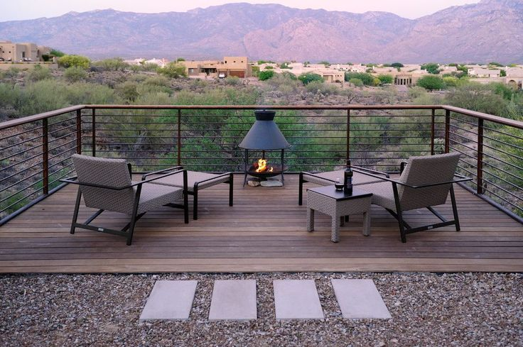 Trex decking cost deck contemporary with concrete pathway wood slat deck metal railing patio furniture natural modern concrete pavers fire feature taupe chair e