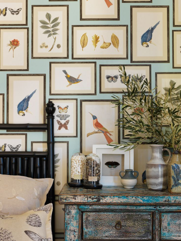 Bedroom gallery wall of colorful bird and floral art