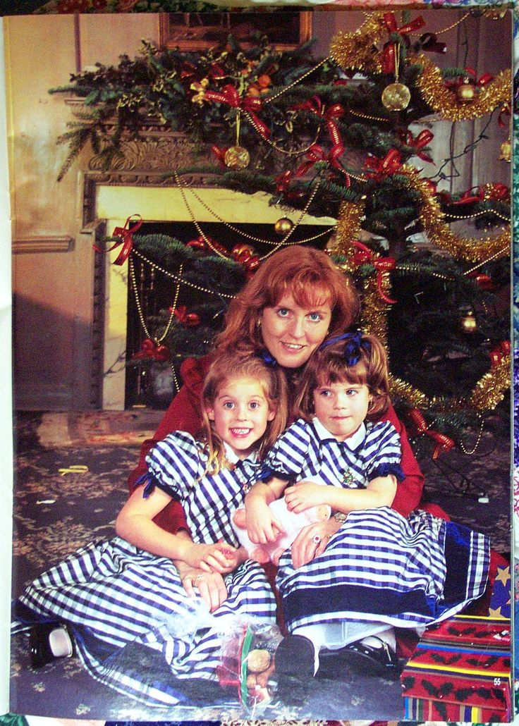 Princess Sarah, Duchess of York with her daughters Princesses Eugenie & Beatrice at home at Christmastime.