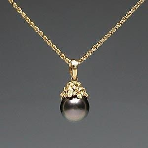 Hawaiian Black Pearl necklace with Gold Plumeria