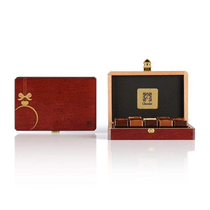 Celebrate the holiday season by gifting this distinguished mahogany box holding 15 of our most popular French chocolates handcrafted by World Champion French Chocolatier Pascal Caffet. [USD 101.10] Discover our Holiday Sapphire: http://www.zchocolat.com/shop/en/holiday-collection/345-holiday-sapphire.html