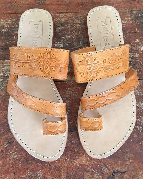 Our hand tooled leather bohemian sandals with mandala hand tooling. www.mahiya.com.au