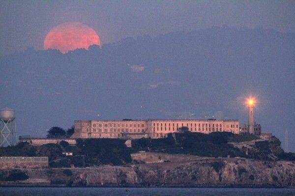 January's winter full moon rose over Alcatraz Island as seen from Fort Point San Francisco, CA.