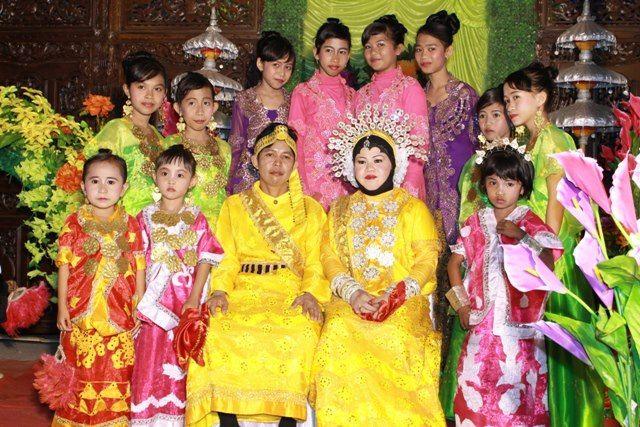Yellow, my cousin and husband. wedding dress Baju Bodo