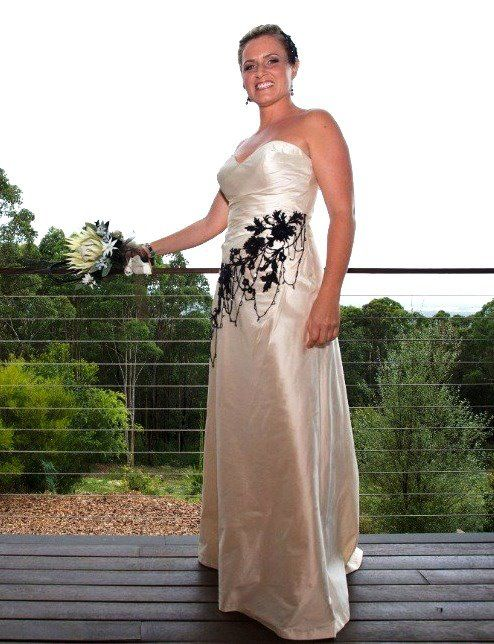 Stephanie's cream strapless sheath gown  http://www.arcarocouture.com.au/stephanie/