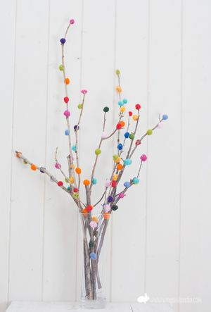 Felt ball Pom-Pom Branches cute for spring or Easter decor. Translator on right of text ... Link for video tutorial to make felt balls included.
