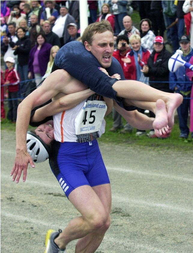 Wife carrying (Estonian: naisekandmine, Finnish: eukonkanto or akankanto, Swedish: kärringkånk) sport which males carrying a female. Goal, male to carry the lady through an obstacle track in best time. Sport first held at Sonkajärvi, Finland. Types of carry practiced: piggyback, fireman's carry, or Estonian-style (wife upside-down w/ legs around husband's shoulders, holding his waist). World Championships held yearly in Sonkajärvi, Finland since 1992, prize is the wife's weight in beer.