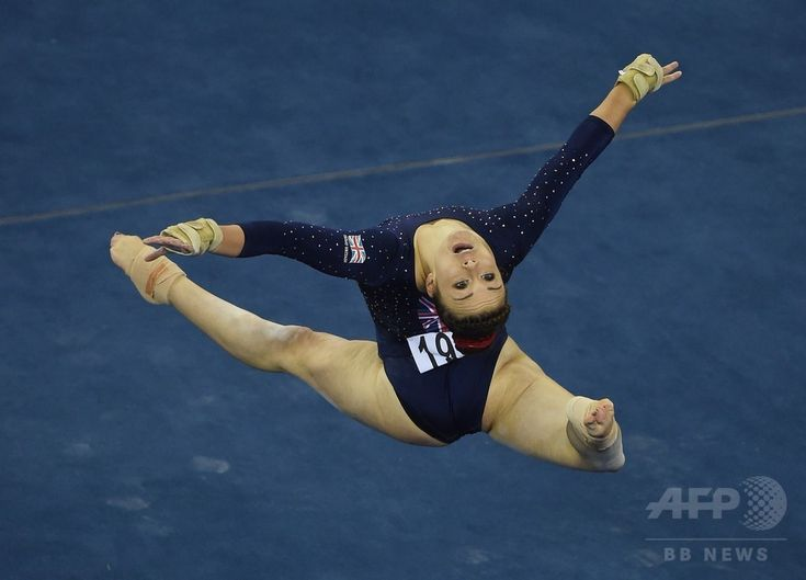 Ruby Harrold of Britain performs on the beam during the women's all-around final at the Gymnastics World Championships in Nanning, in China's southern Guangxi province on October 10, 2014.(c)AFP/Greg BAKER ▼13Oct2014AFP|【写真特集】カメラがとらえた世界体操のワンシーン http://www.afpbb.com/articles/-/3028472