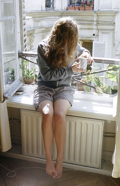 a peaceful moment by the window with coffee of course