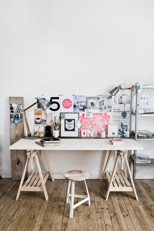 Displaying pictures on a wide wood board is genius. Get a big tall one from home depot, stain it and mount favourite black and whites. Put it on a wall perpendicular to TV