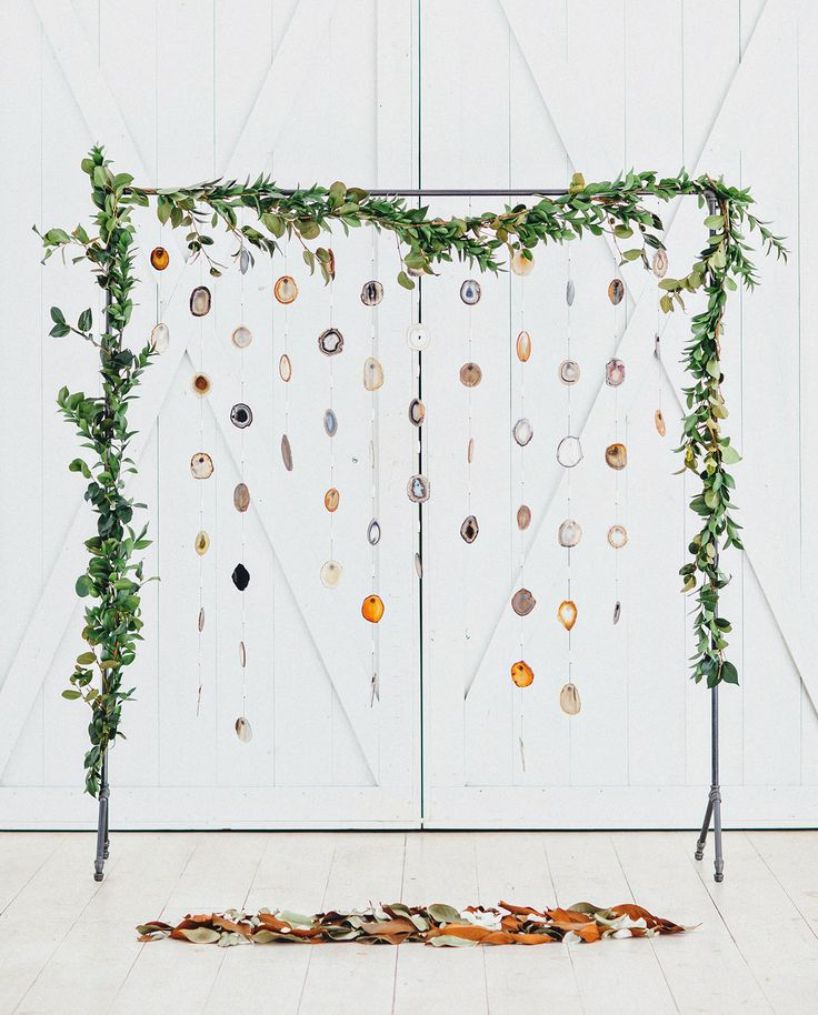 geode backdrop with greenery for the modern boho bride