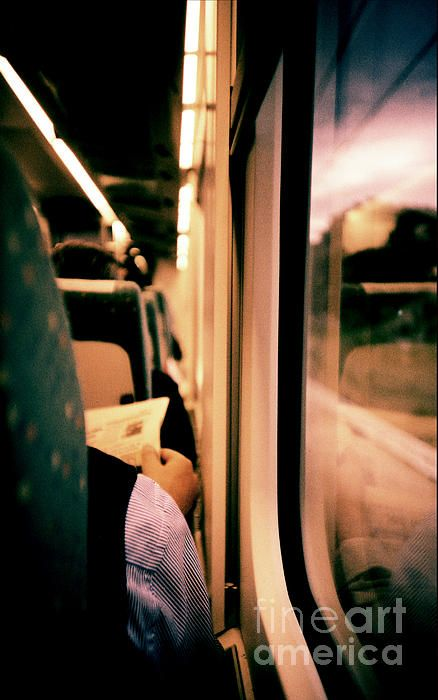 Man on train - Lomo LCA xpro cross processed slide film in c41 color negative cemicals from lomographic lomography Russian toy compact camera analog 35mm film by Edward Olive.