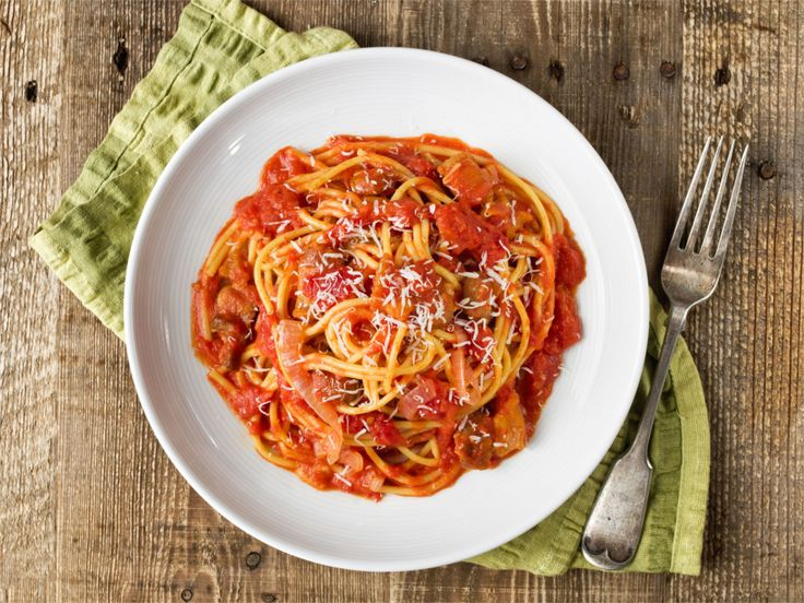 The bucatini Amatriciana are a simple but exceptionally tasty Italian dish. But what is pasta Amatriciana?The original recipe is made with cured pork cheek, tomatoes, pecorino romano cheese and pepper, and hails from Amatrice - from which the name - a small town situated in the province of Rieti, at the border between Lazio and Abruzzo, recently hit by a terrible earthquake.Amatriciana HistoryThe pasta Amatriciana originates among the poorest, as most of the most delicious recipes in the…