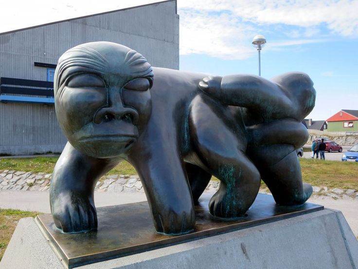 This figure of the orphan Kaassassuk by Greenlandic artist Simon Kristoffersen (1933-1990) is outside the Greenland Home Rule Parliament (Inatsisartut) in Nuuk.