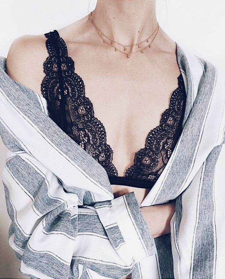 Fine star necklaces, expensive lingerie, beautiful girl. French chic with a classic striped shirt, black lace bralette and delicate fine necklaces. Click to shop beautiful fine necklaces now.