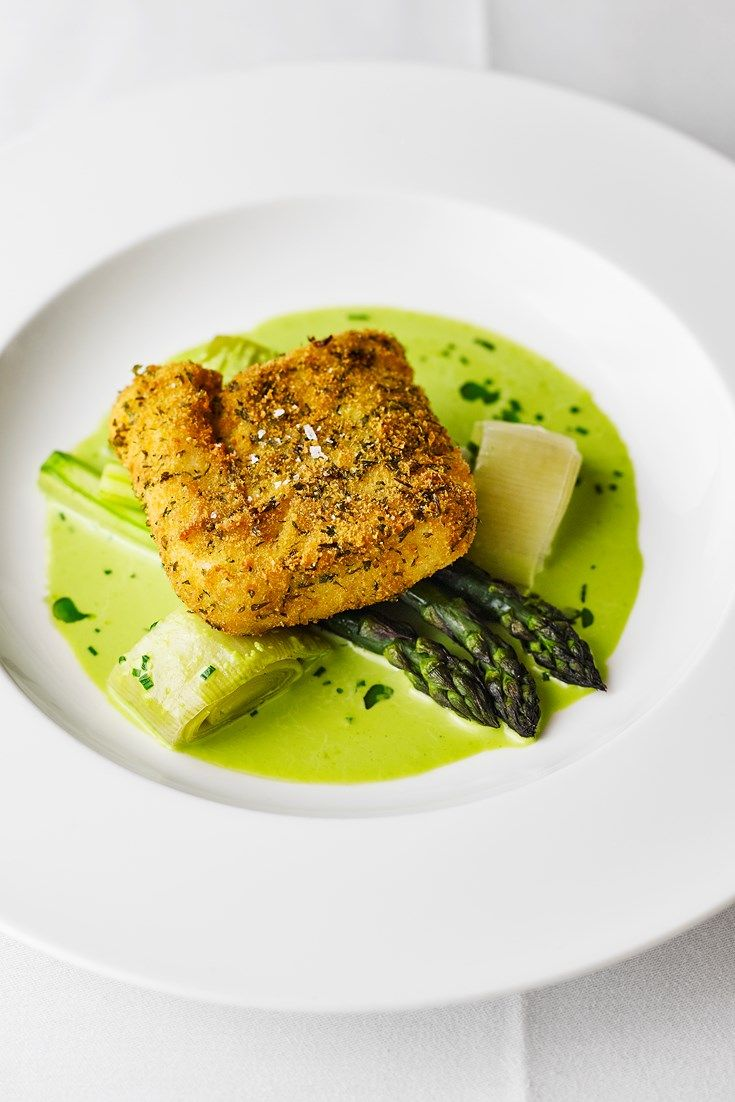 A fantastic hake recipe from Pete Biggs, this breaded fish dish with fried and baked hake showcases spring ingredients with grilled asparagus and a delicious wild garlic sauce.