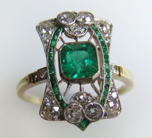 Emerald and Diamond Ring  1900s    A beautiful Art Nouveau ring, circa 1905. Set with emeralds and old brilliant-cut diamonds, mounted in platinum and gold.