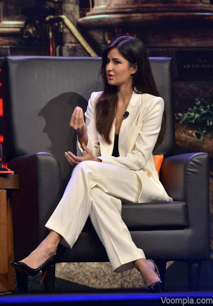 Katrina Kaif is all business in a white Isabel Marant pant suit and black Christian Louboutin heels. via Voompla.com