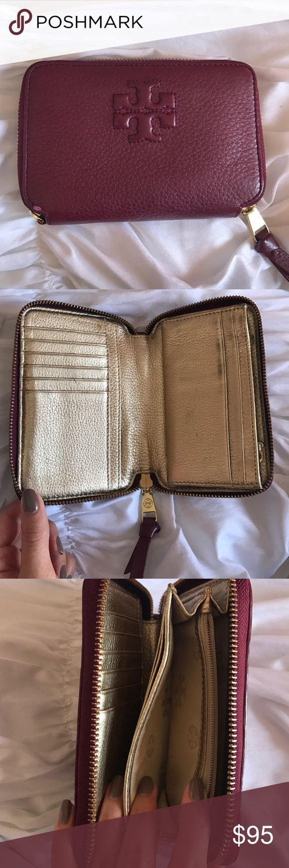 Tory Burch Smart Phone Wallet Deep purple wallet with gold interior. Fits an iPhone. Comes with original tag. Tory Burch Bags Wallets