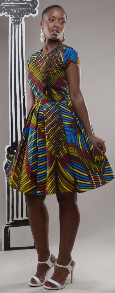 NEW - Dazzle Alice-in-wonderland African print pleated dress by GITA'S PORTAL. BACK BY POPULAR DEMAND in a brand new fabric. This beautiful Alice in Wonderland dress has hints of the 50s. It's a playful yet demure dress that's a stunner and bound to fetch you compliments. Has a sweet edginess to it. Pleated detail at waist gives you structure and a very flattering fit. It comes with a fabric belt. (affiliate)