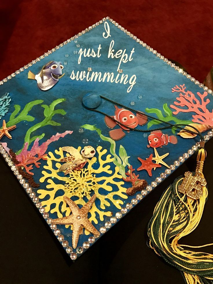 "Dory ""I just kept Swimming"" cap done by ""flip yo cap"" #sacstate #fall16 #dory #graduation #college #gradcap #graduationcap #cap #findingnemo #findingd"
