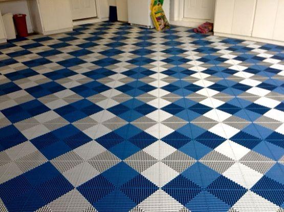 White & blue vented grid-loc rubber garage floor tiles
