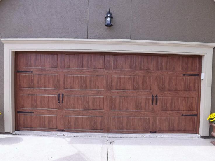 Clopay gallery garage door ultra grain dark oak for Wood grain steel garage doors
