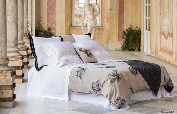 The Black Pearl #bedroom features a big bold floral pattern with metallic silver embroidery accents.