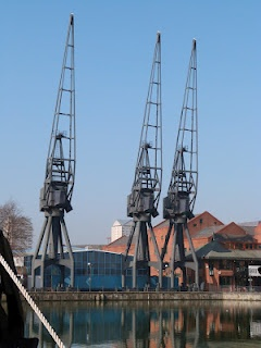 A few cranes still remain in London's Docklands - a reminder of the past when exports and imports were not 'invisibles'