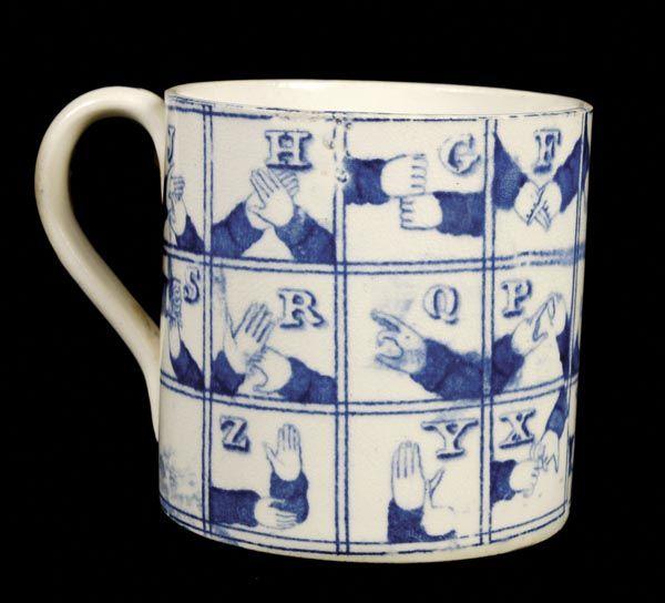 A Staffordshire mug with a blue-and-white sign-language alphabet, c.1825.