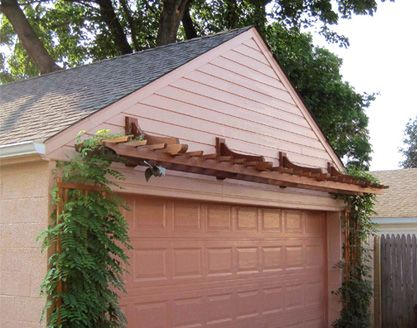 soften a stark garage with a pergola/arbor over the doors - help bring down the scale of tall blank expanse