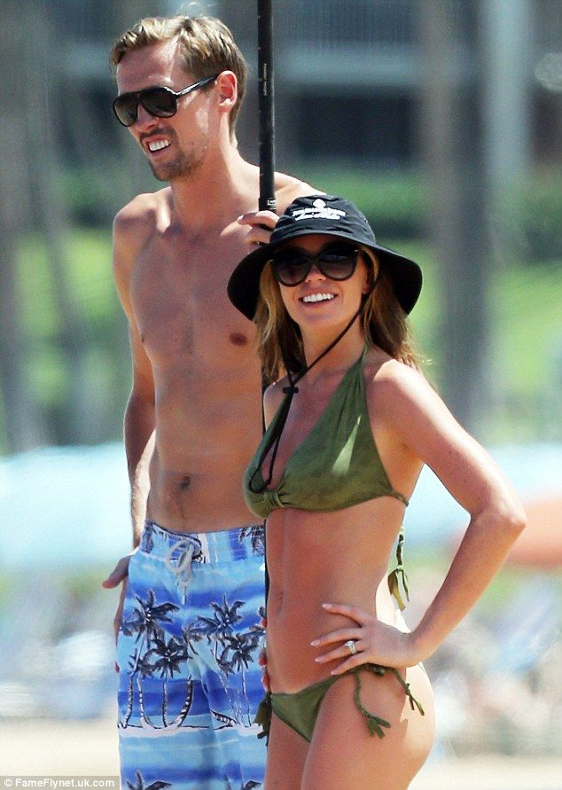 Loved up: Abbey and husband Peter Crouch are currently in Hawaii on holiday...