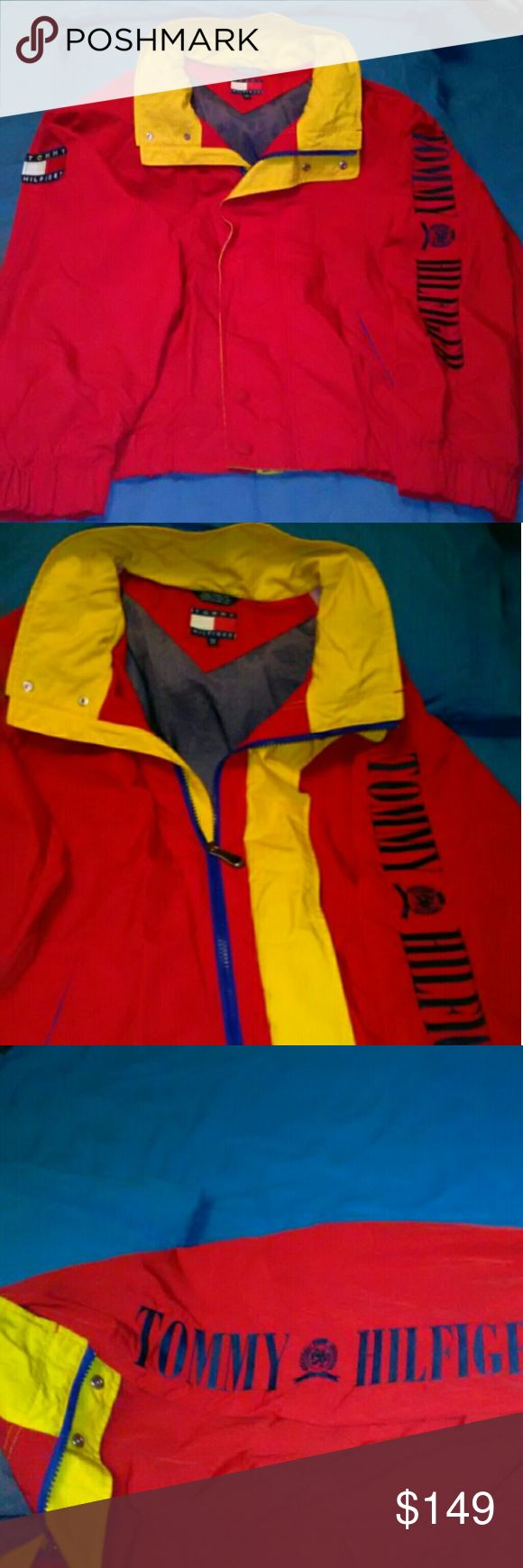 🇺🇸 Tommy Hilfiger 🇺🇸  Men's 🆒 Vintage Jacket 🆒  🇺🇸 Tommy Hilfiger 🇺🇸 Vintage Jacket  🌟 Like New 🌟 - Only worn few times  ⏩Colors: Red with Yellow & Blue Trim ⏩Tommy Flag on Shoulder ⏩Tommy Hilfiger Spell-out on Sleeve ⏩Size XXL ⏩Light/Medium Weight ⏩Zipper & Button Front Closure ⏩Two Exterior Pockets ⏩Fold Away Hood ⏩Stretch Elastic Cuffs & Waistband ⏩Fabric Nylon Exterior & Polyester Lining ⏩No Noticable Flaws or Defects Tommy Hilfiger Jackets & Coats Bomber & Varsity