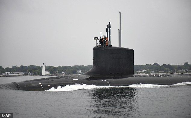 The submarine USS Illinois travels along the Thames River after departing General Dynamics Electric Boat in Groton, Connecticut, for initial sea trials, where the ship's performance is tested prior to delivery to the U.S. Navy (July 2016 photo)