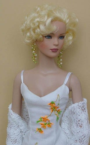 Beautiful/ I'm seeing a lot of this. I started embroidering on Barbie clothes in the 1990's